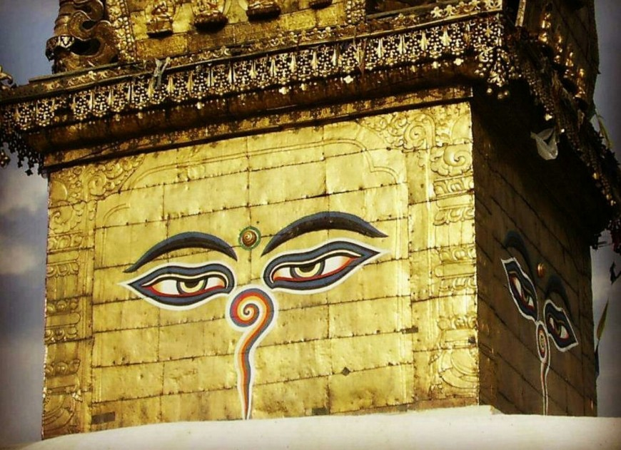 Buddha eyes at the center of the four faces of golden walls in Kathmandu.