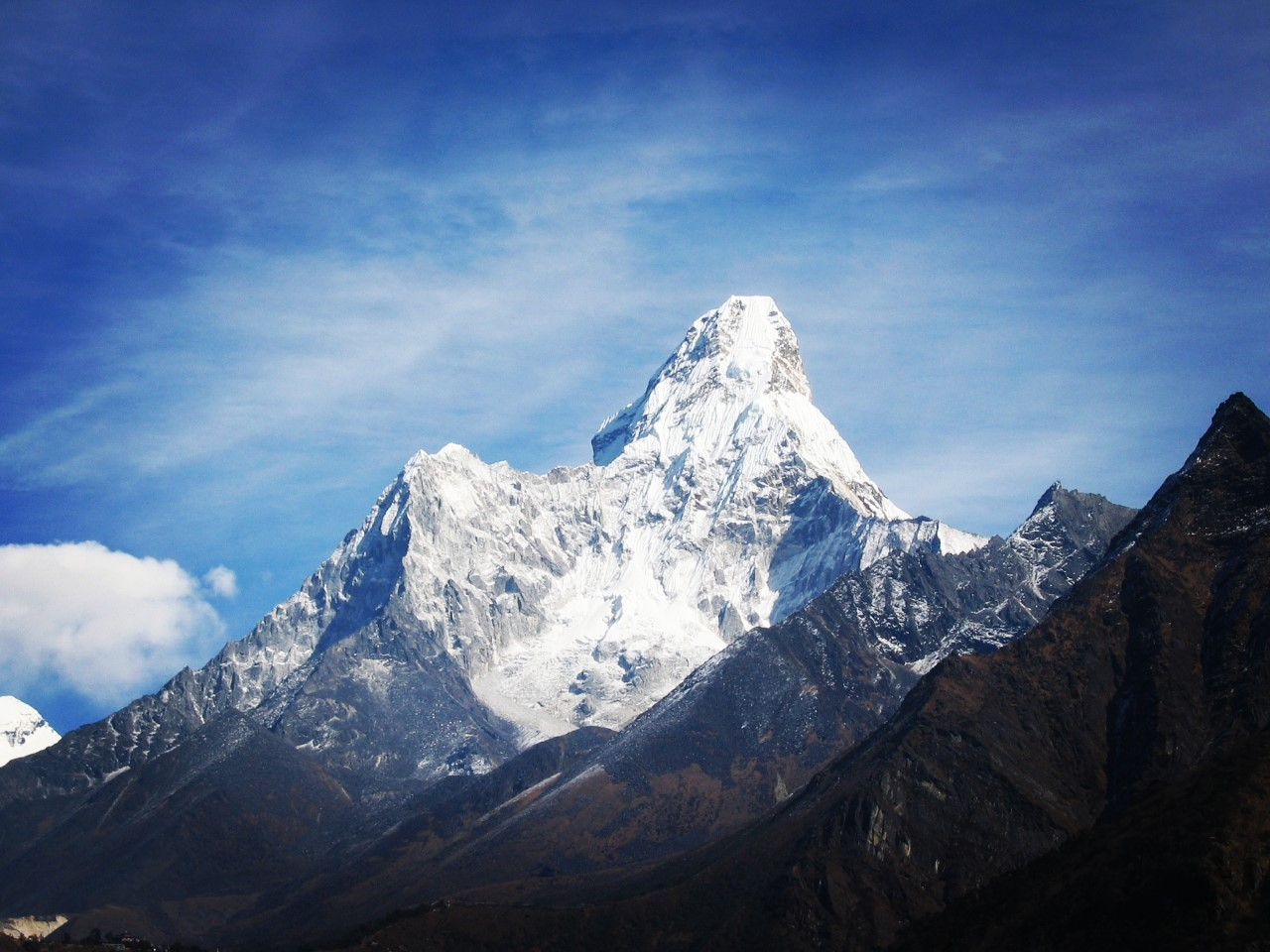 a picture of Ama dablam mountain covered with snow