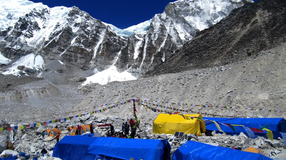 A group of campers setting up their tent at the glacier mountain in Everest Base Camp.