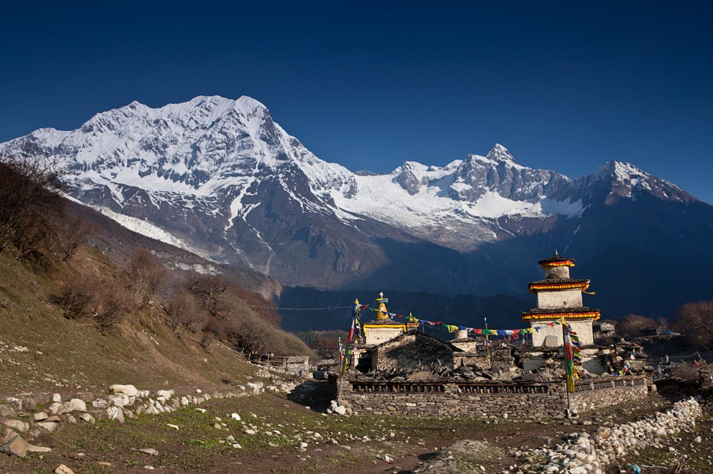 a wide view of a temple and a mountain full of thick snow.
