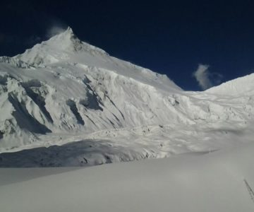 view of manaslu mountain covered with thick snow