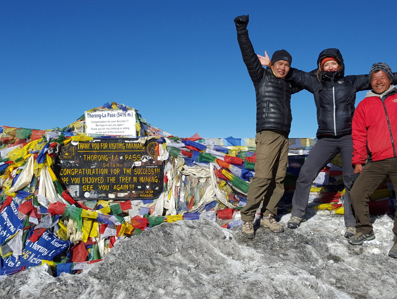 3 himalayan trekkers took a picture in thorong-la pass