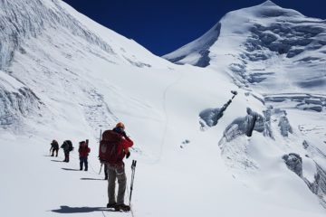 Mountaineers walking on a mountain glaciers of the Himalayan Mountains