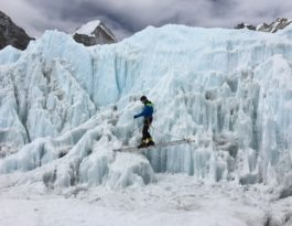 an ice climber in a ladder on Himalayan Mountain Glaciers