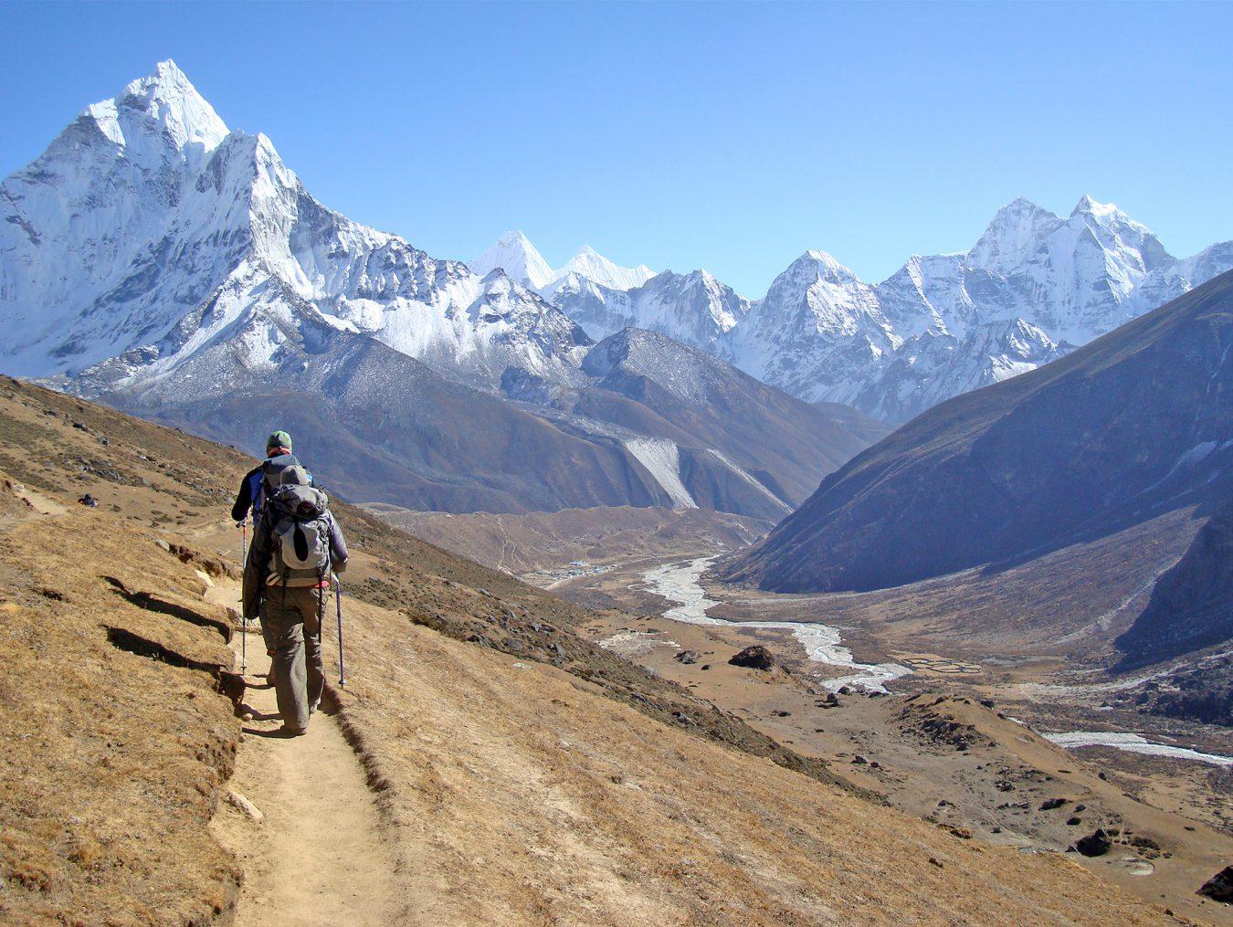 2 mountaineer trekking in himalaya