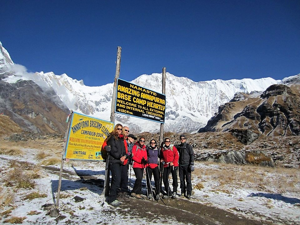 a group of trekkers in an Annapurna base camp that took a picture with themselves at the himalaya mountains