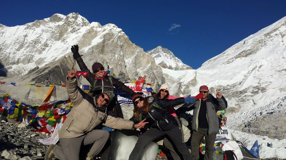 a group of mountaineer taking a picture in the peak of mountain