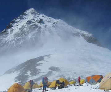 View in mt. everest with group of people in their yellow tents.