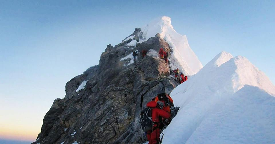 himalayan trekkers at the highest point in Mount Everest