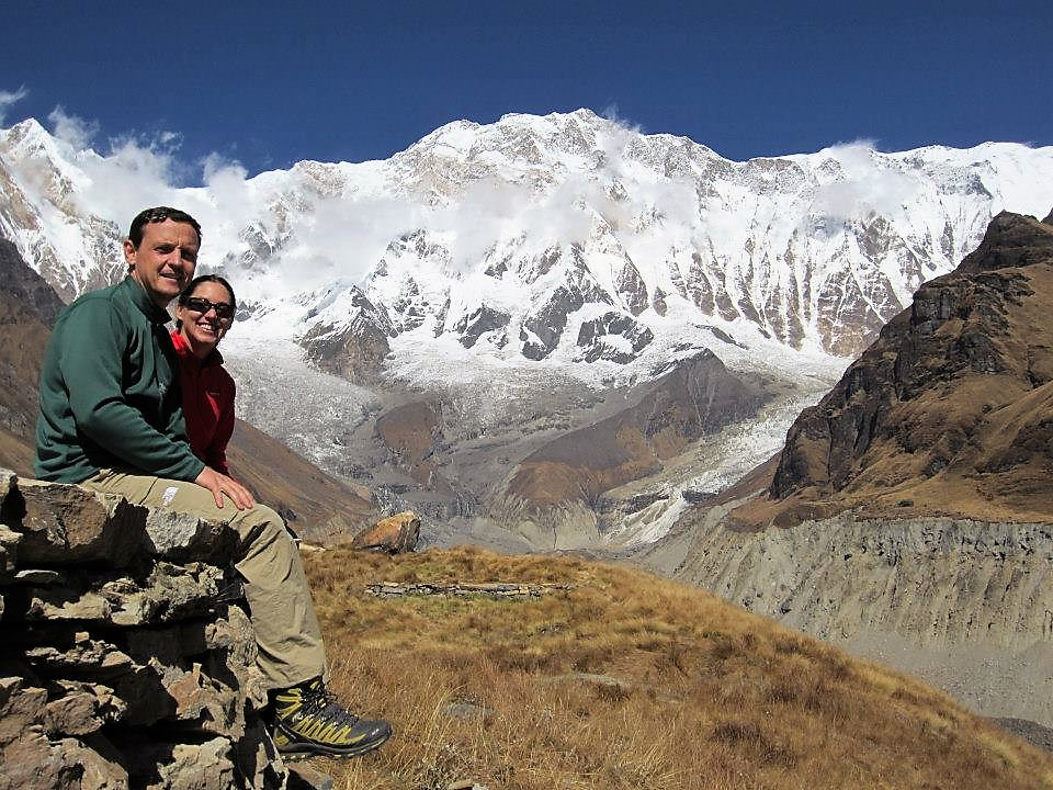 a couple in in himalaya mountain that is covered with snow