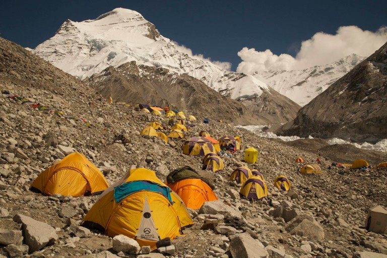 Group of yellow tents in the lower area of the cho oyo mountain.