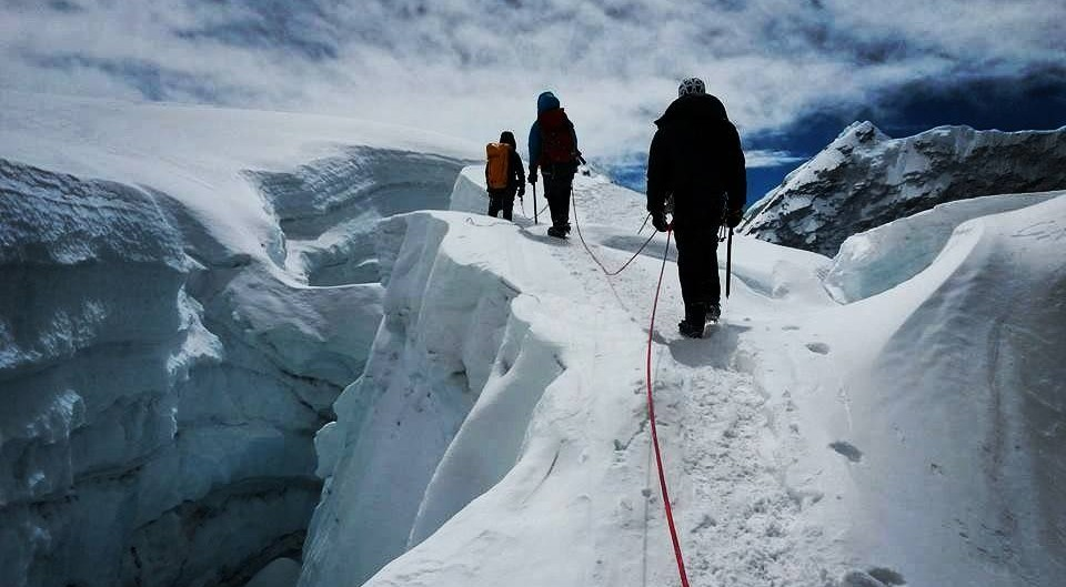 3 mountain climbers walking on the mountain glaciers