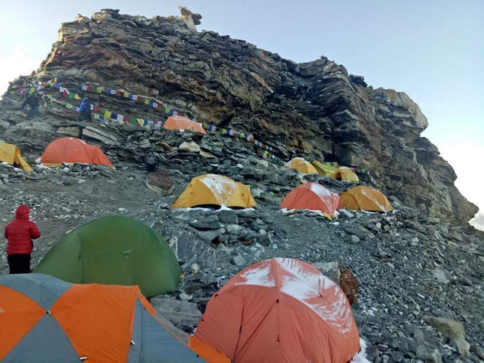 base camp with prayer flag at the rocky mountain