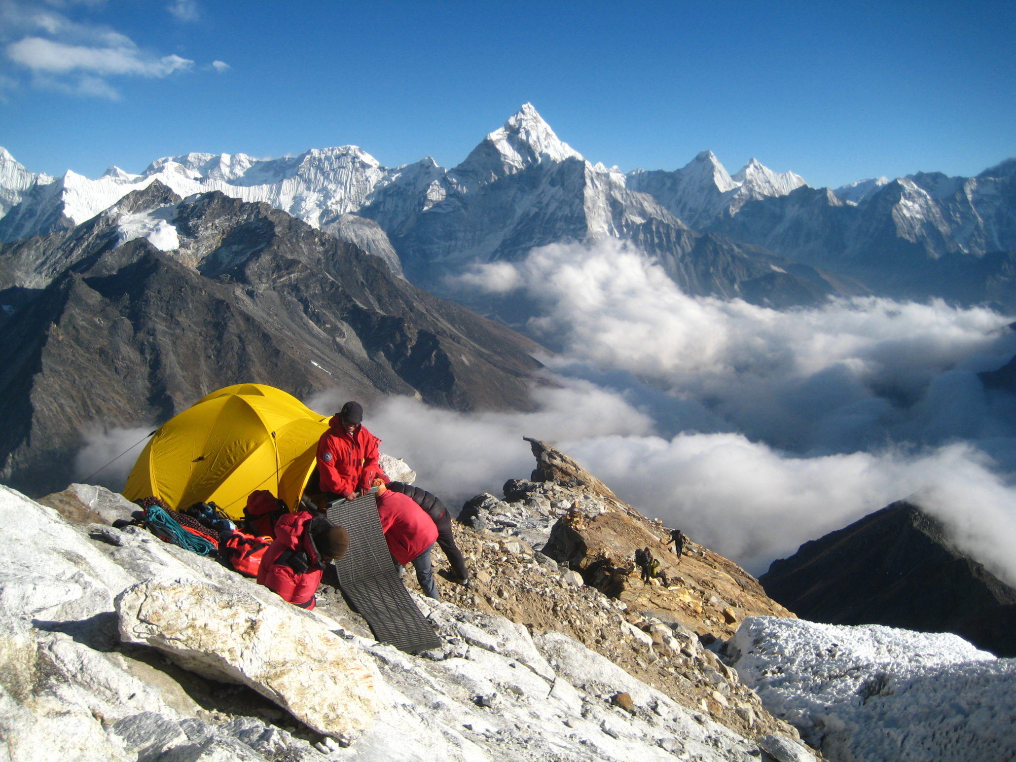 campers on the peak of Himalayan Mountains